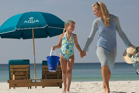 mother and daughter on the beach at Aqua Resort