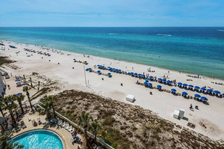 view of the gulf of mexico and pool at aqua resort from condo rental balcony
