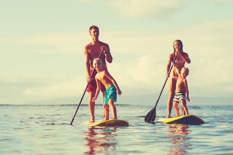 family on paddleboards